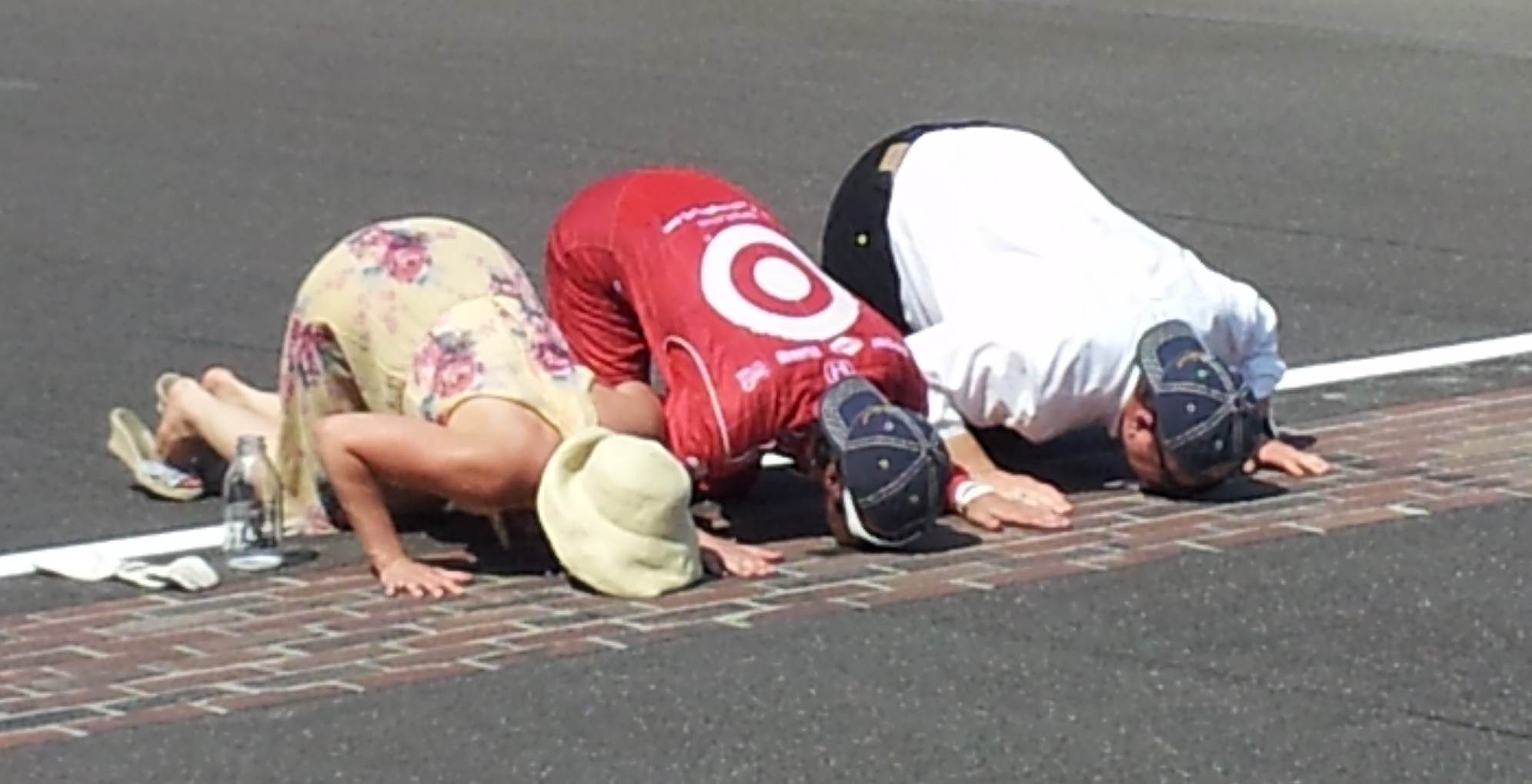 Ashley, Dario and Chip Ganassi kiss the bricks