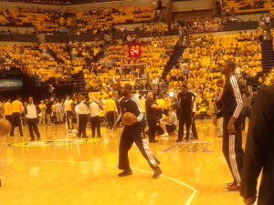 Miami's Dwyane Wade, center, and Chris Bosh, right, warm up while surrounded by Gold Swagger. Photo by Cliff Brunt.