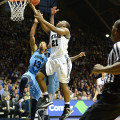 Roosevelt Jones (21) scores against Rhode Island.