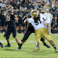 Purdue's Rob Henry (15) throws against Notre Dame.