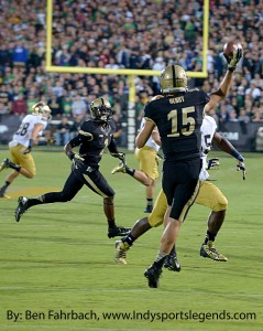 Purdue quarterback Rob Henry (15) throws on the run against Notre Dame.