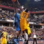 Orlando rookie Victor Oladipo gets his shot blocked by Indiana's Ian Mahinmi. Jessica Hoffman/Pacers
