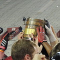 Indiana players celebrate Saturday with the Old Oaken Bucket trophy. (Photo by Chris Goff.)