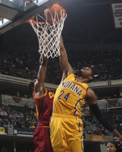 Paul George throws it down for two of his 21 points Saturday night.  Photo by Jeff Clark, Pacers Sports and Entertainment.
