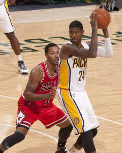 Chicago's Derrick Rose guards Indiana's Paul George earlier this season. Photo by Frank McGrath, Pacers Sports and Entertainment.