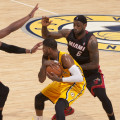 Dwyane Wade, left, and LeBron James, right, swarm Pacers forward Paul George early this season. Photo by Frank McGrath, Pacers Sports and Entertainment.