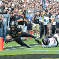 Purdue's Danny Anthrop reaches for the pylon. Photo by Ben Fahrbach.