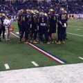 Notre Dame huddles on the field at Lucas Oil Stadium. Photo by Brock Sanders.