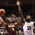 Purdue's Rapheal Davis (35)  defends against Minnesota's DeAndre Mathieu. Photo by Purdue Athletics.