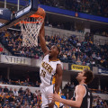 Ian Mahinmi slams one home against the Nets. (Photo by Pacers Sports and Entertainment)
