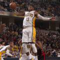 Paul George skies for a rebound against the Raptors.  (Photo by Pacers Sports and Entertainment)