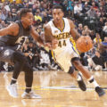 Jeff Teague drives on Yogi Ferrell. Teague had 9 points, 9 rebounds, and 8 assists in the Pacers win. (Photo by Pacers sports and entertainment)